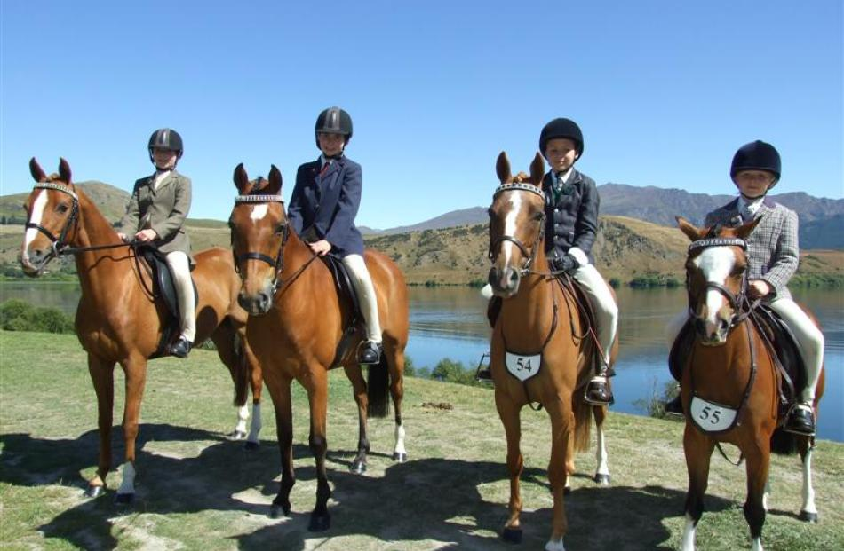 Young riding competitors are Charlotte Chapman-Cohen (11) on Abapsley Gentle Ways, Penelope...