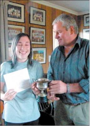 Rebecca Ryan (17) is presented with the Dawson trophy for her Waikaka team winning the A reserve...