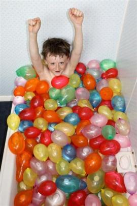 Junior Winner: Baths, laughs and balloons - Harry Ross (12) is well prepared for a water balloon...