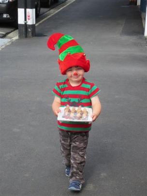 Weekly Winner 1: Santa's helper - Ben Baskett (2) carries a plate of teddy bear racing cars to a...