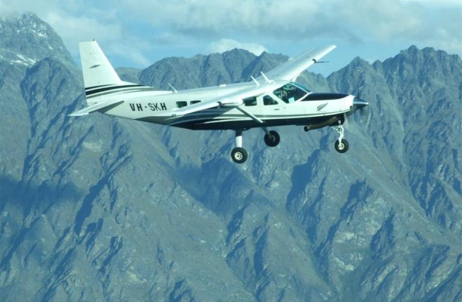 The Cessna with Hank and Antony Sproull on board flies  near the Remarkables as they arrive home...