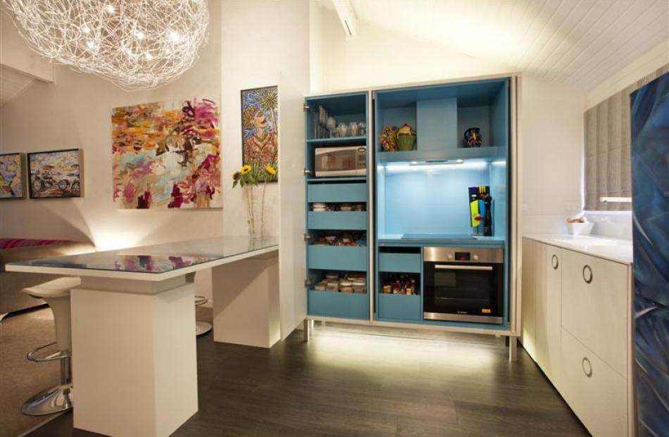 Sian Gillanders' own kitchen provides elements of surprise. Colour is used on the inside rather...