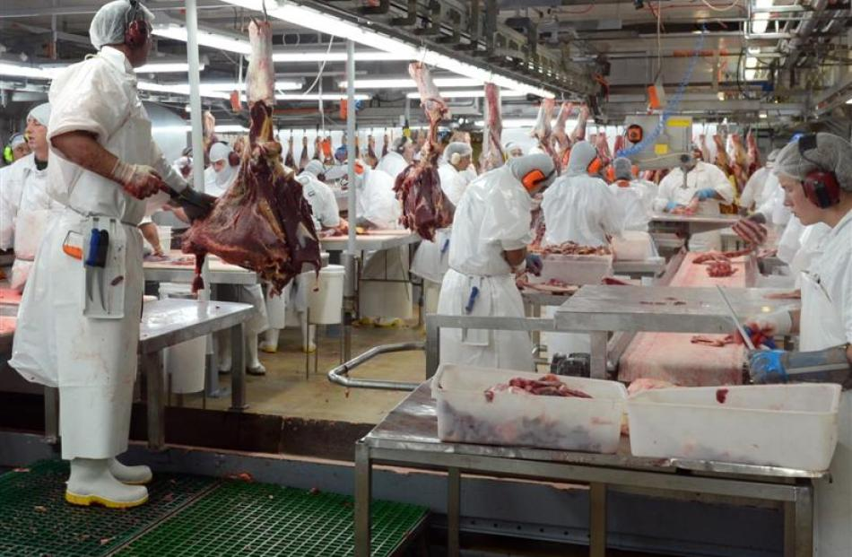 Silver Fern Farms workers process beef carcasses at Finegand freezing works. Photos by Stephen...