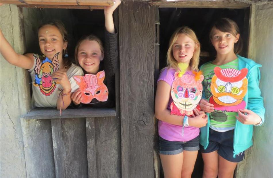 Zoe Ries (9), Jessica MacDonald (8) and Amelia Peasey (10), all of Arrowtown, with Emily Spicer ...
