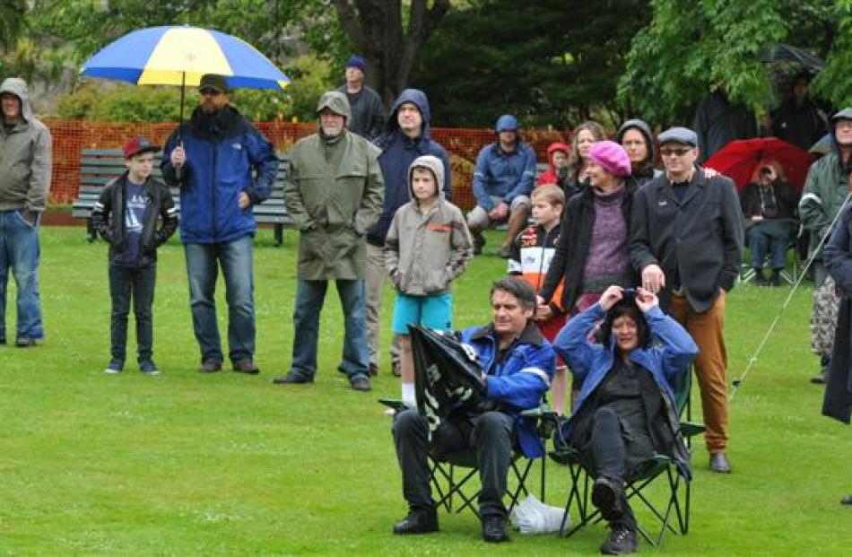 Hardy fans listen to the Bats as the rain pours down.