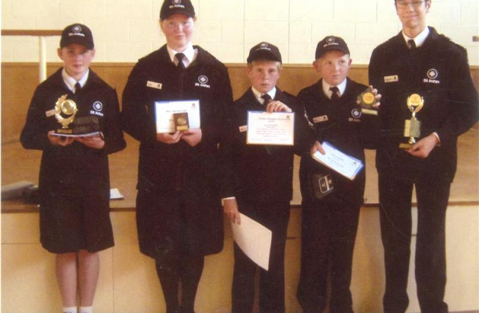 Celebrating their success at a recent prizegiving are Mosgiel St John Youth Cadets (from left)...
