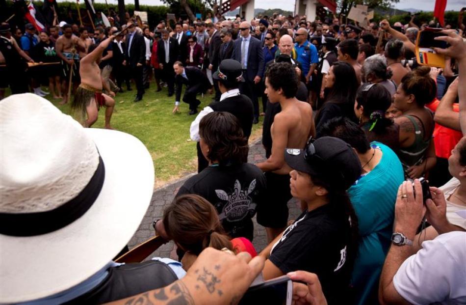 Prime Minister John Key walks on to Te Tii Marae  in Waitangi. Photos by The New Zealand Herald.