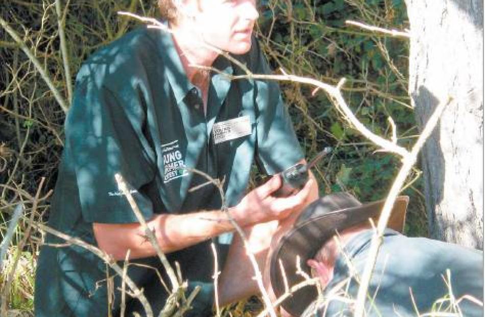 Emergency: Omakau's Daniel Thurlow (26) uses his first-aid skills on chainsaw victim Michael ...