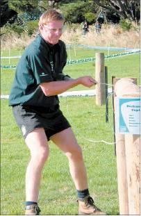 Not enough tension: Pukerau's Richard Copland ( 29 ) uses some muscle to tame his fence.