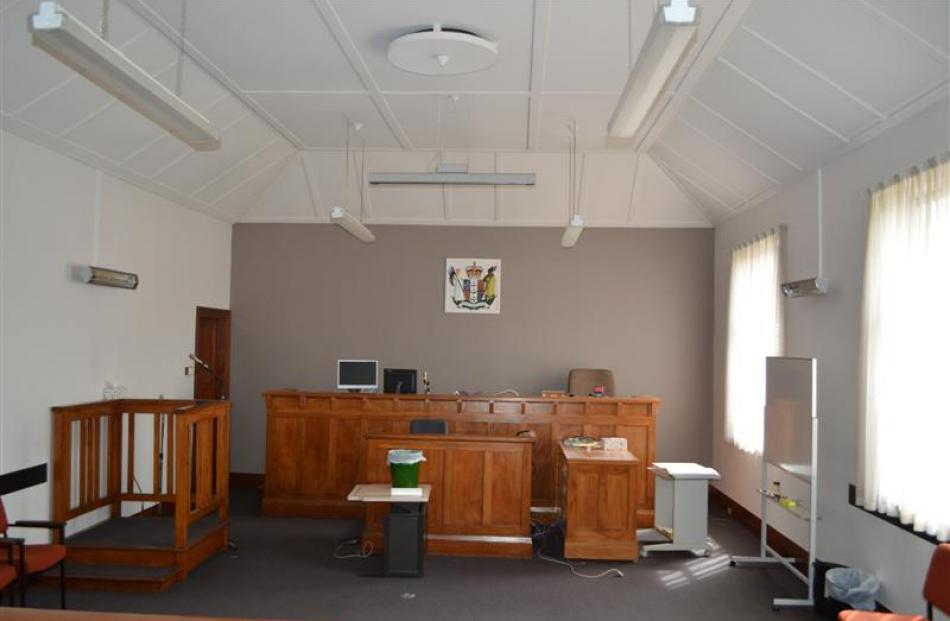 The  courtroom, looking towards the judge's bench from the public gallery. Like the rest of the...