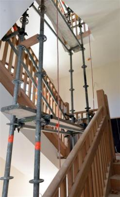 Scaffolding remains as contractors complete the finishing touches of earthquake strengthening and...