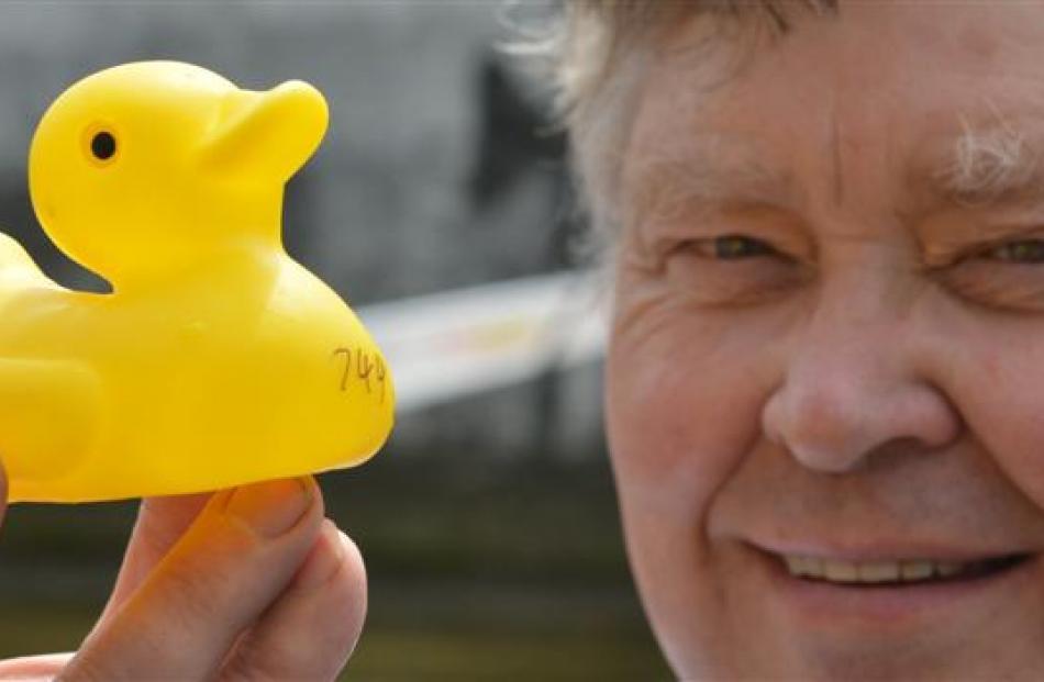 Competition organiser John Nelson holds up the winning  duck.