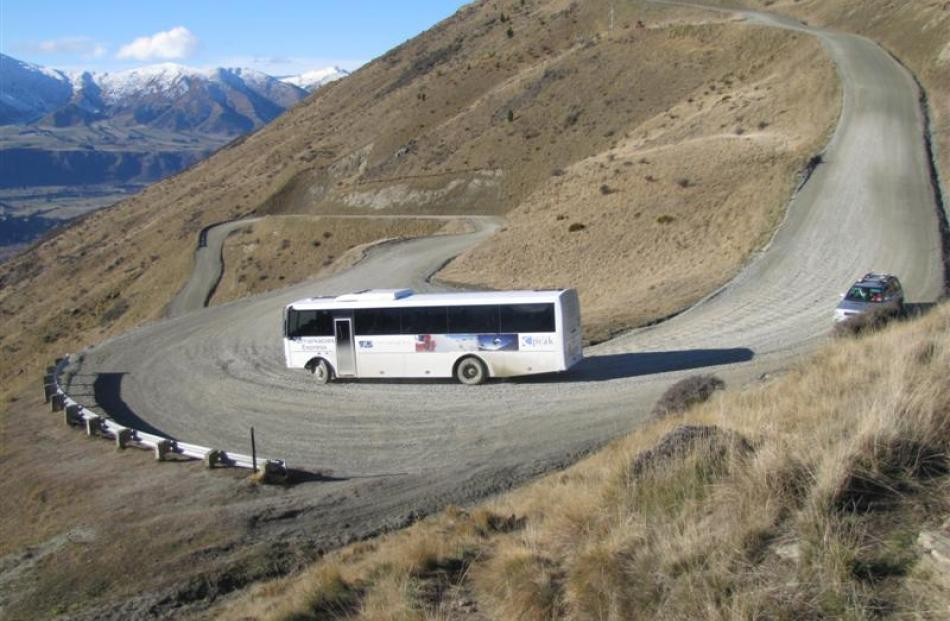 A Remarkables skifield 4WD bus negotiates a twisting section of the access road as it ferries...