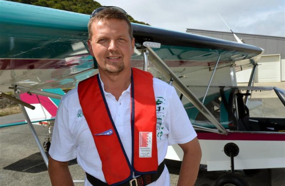 Craig Buist beside his amphibious aircraft.