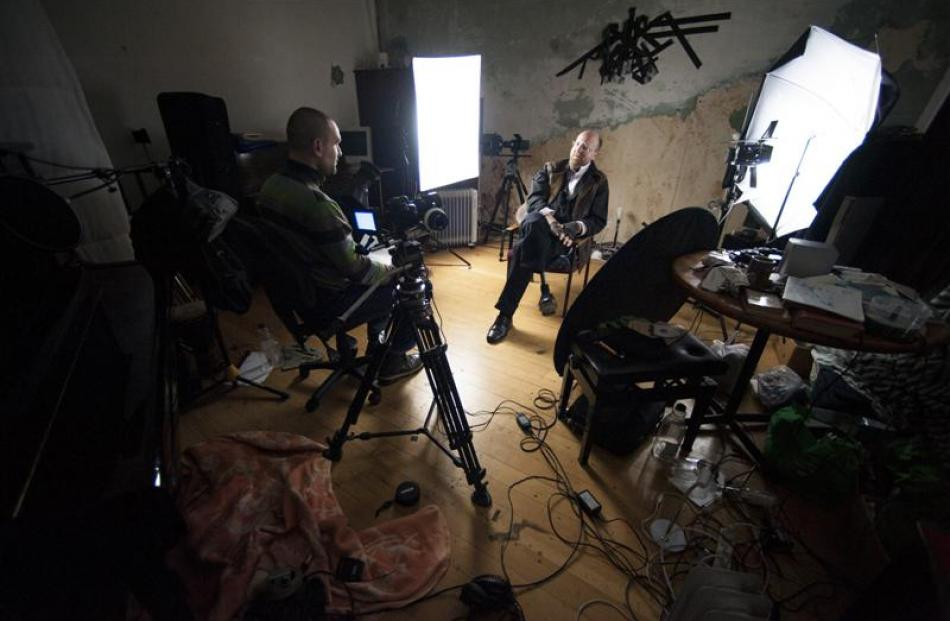 Dunedin musician Nick Knox (right) is interviewed by J. Ollie Lucks during filming of mini...