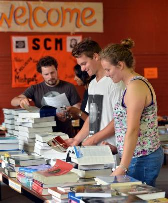 Looking at books at the Student Christian Movement (SCM) book exchange yesterday were (from left)...