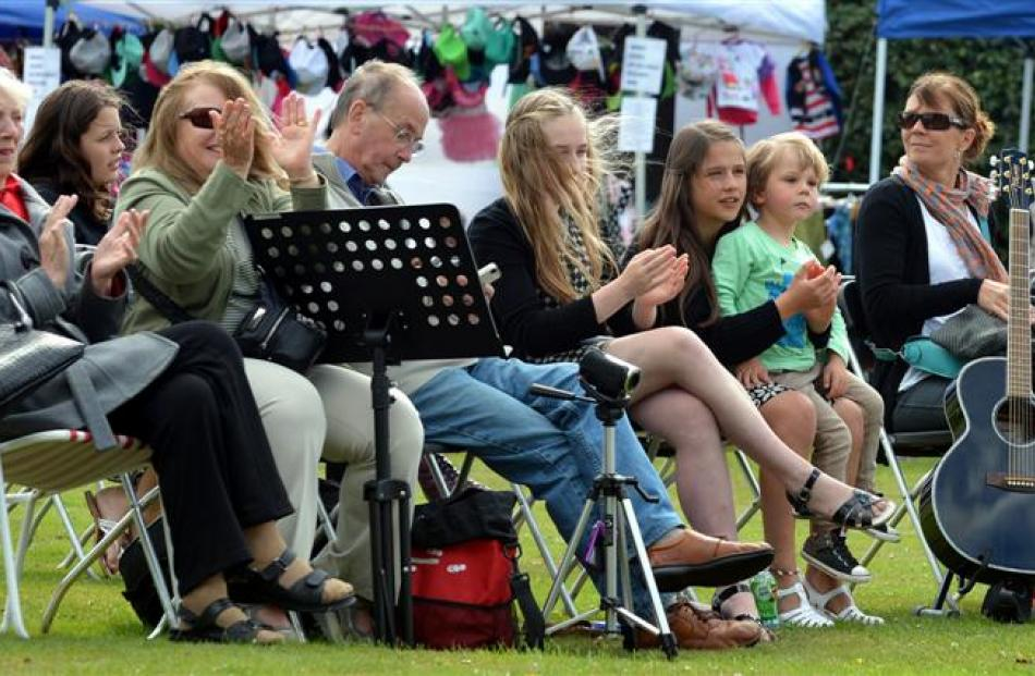 Members of the crowd watch the entertainers at Party in the Park in Mosgiel yesterday. Photos by...
