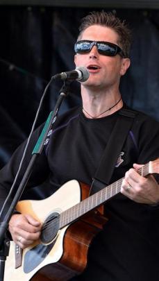 Kelvin Cummings, of Dunedin, performs for the crowd.