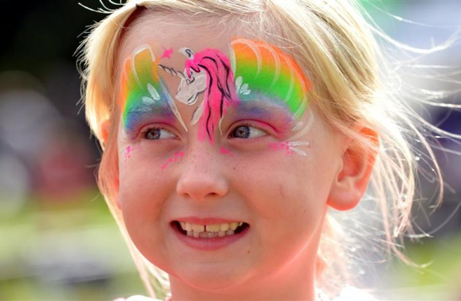 Paige King (6), of Mosgiel, is all smiles after having her face painted at Party in the Park in...