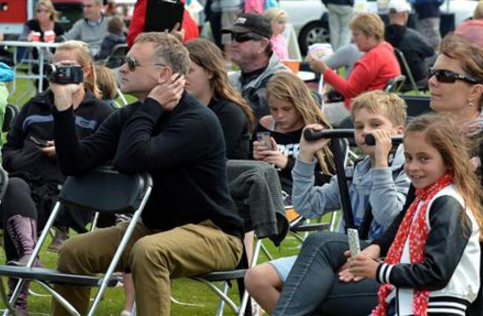 People  watch entertainers at Party in the Park in Mosgiel on Sunday.