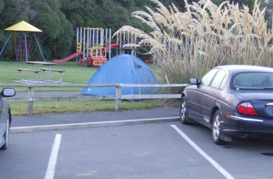 Freedom campers are pitching tents in the Macandrew Bay playground, next to a trial freedom...