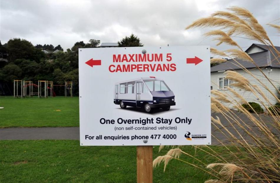 Macandrew Bay's trial freedom camping site is at times attracting up to six  times the intended...