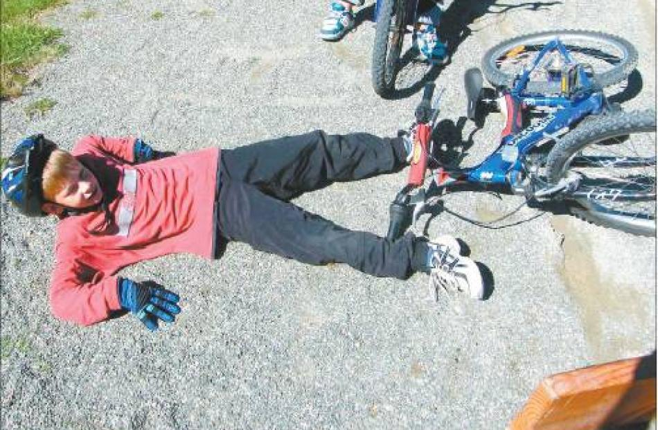 Toby Burdon (8) lies sprawled on the ground after not quite managing to stop in time at the...