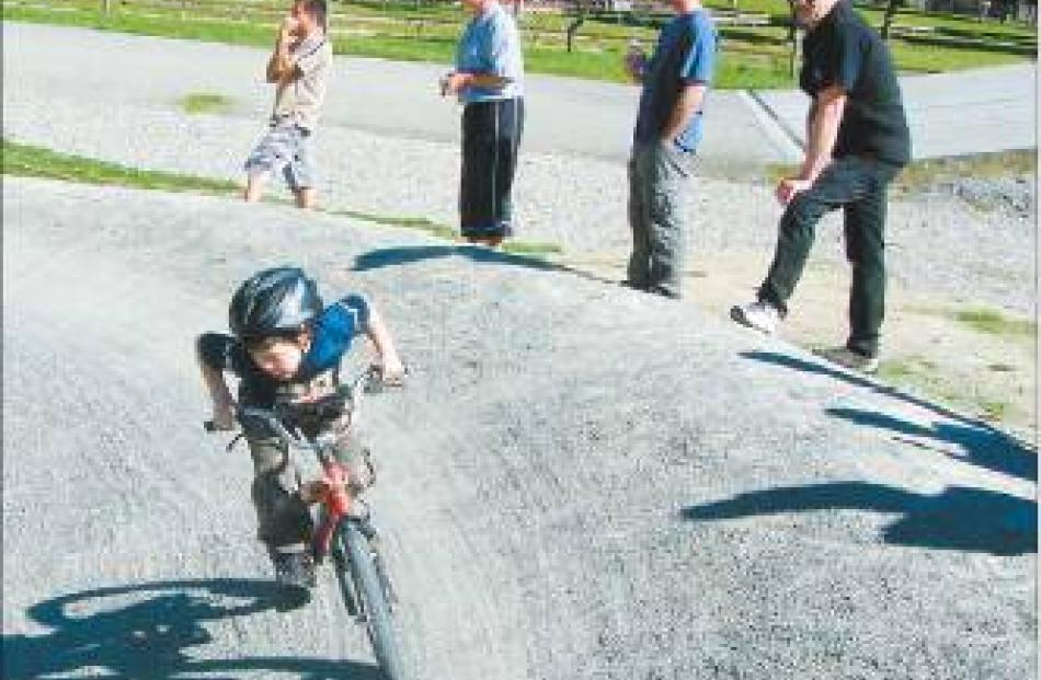 Jacob Bell (6) powers around the banked curve of the BMX course at Hamilton Park on Sunday.