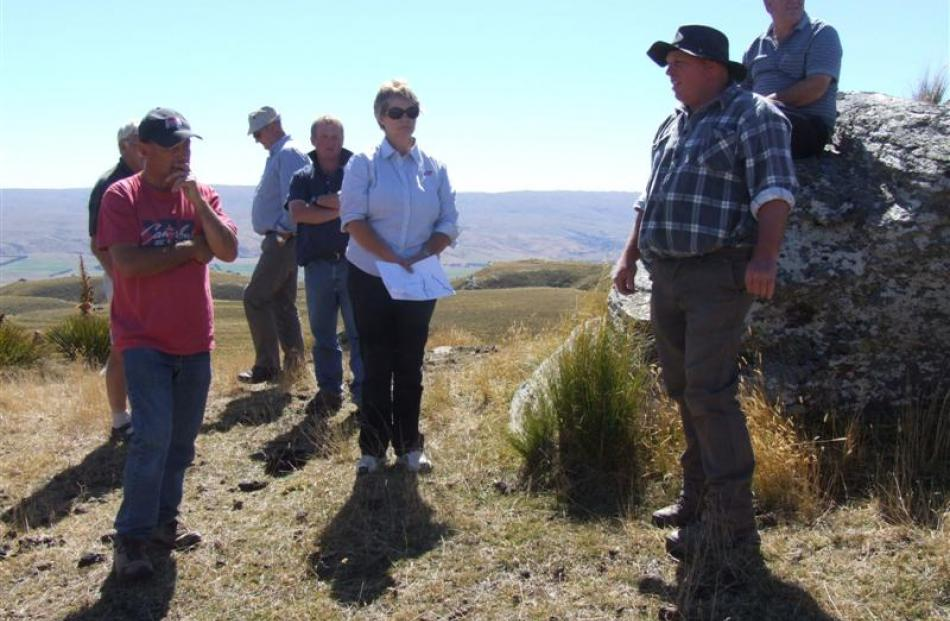 Drew Dundass (right, in check shirt) addresses a field day at Glen Ayr, in the Paerau Valley.