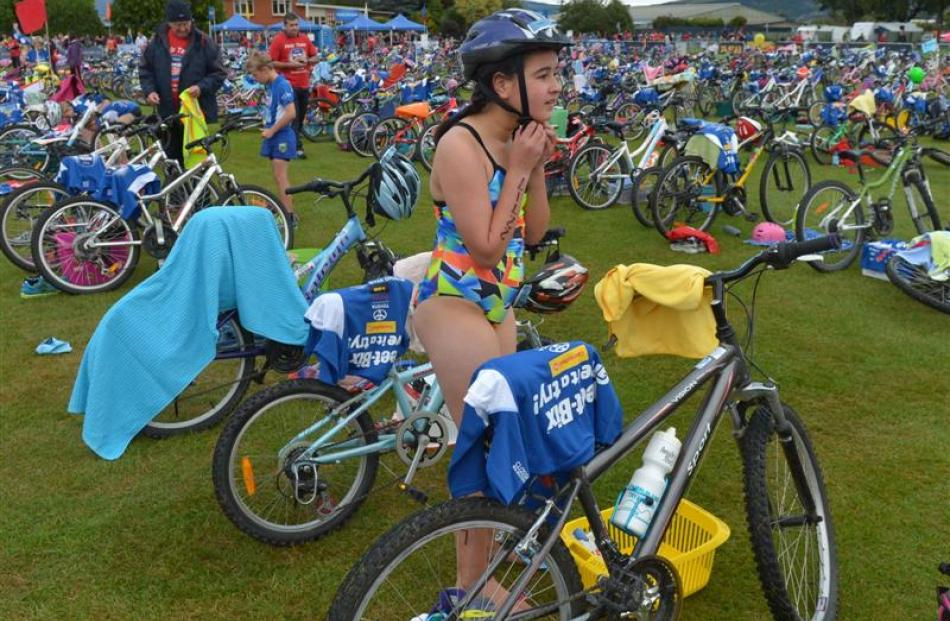 Analee Toro (10), of Mosgiel, fresh from completing the 75m swim prepares to start the 4km bike.