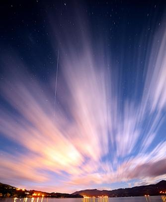 The International Space Station(streak of light) passes over top of Dunedin. Photo by Ian Griffin