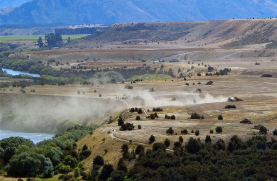 A tractor works land last month  at south Hawea Flat which is within an area surveyed in the mid...