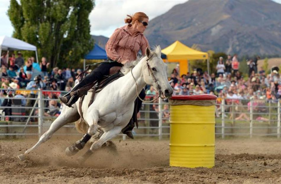 Angie Meehan, of Wanaka, turns for home during the barrel race event at the national rodeo final,...