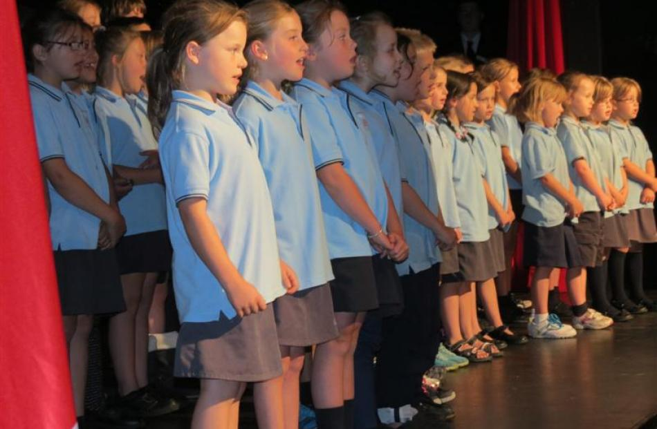 Queenstown Primary School pupils sing the New Zealand national anthem at the start of the college...