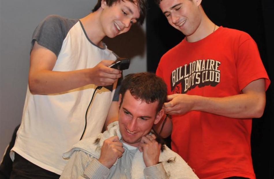 Otago Boys' High School maths teacher Patrick Bassin has his hair shaved off by pupils Hamish...