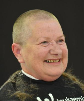 Sharon Rohtmets, of Dunedin, goes from long hair to no hair after her head was shaved at Farmers ...