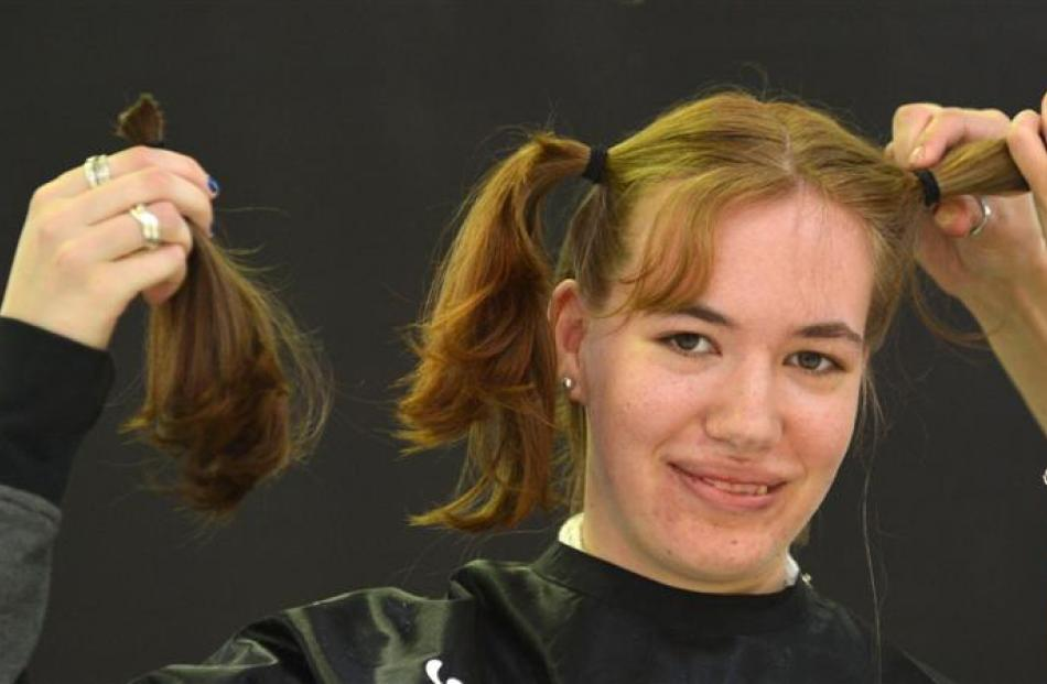 Student Merel Monteiro (18), of Dunedin, shows off her locks at Farmers  on Thursday. She then...