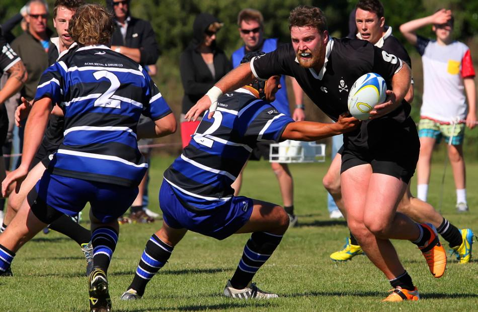 Travis McIntosh (with ball) drives through the Kaikorai tacklers and towards the tryline. Photo...