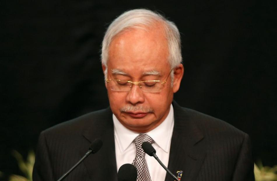 Malaysia's Prime Minister Najib Razak Putra announces that the missing airliner ended its journey...