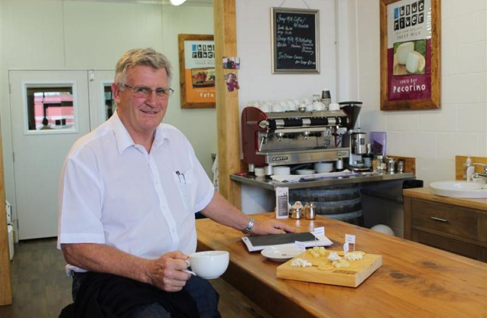 Blue River Dairy founder Keith Neylon enjoys coffee in the tasting room, shop and cafe at the...