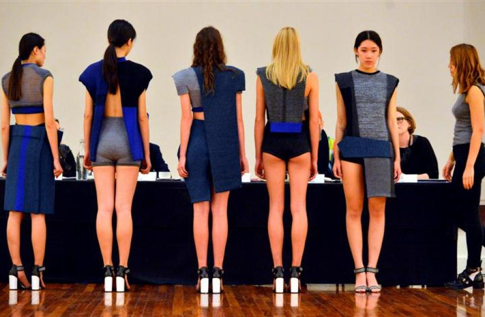 Sydney designer Anna-Marie Gruber (22, right) talks to the judges about  her collection ...