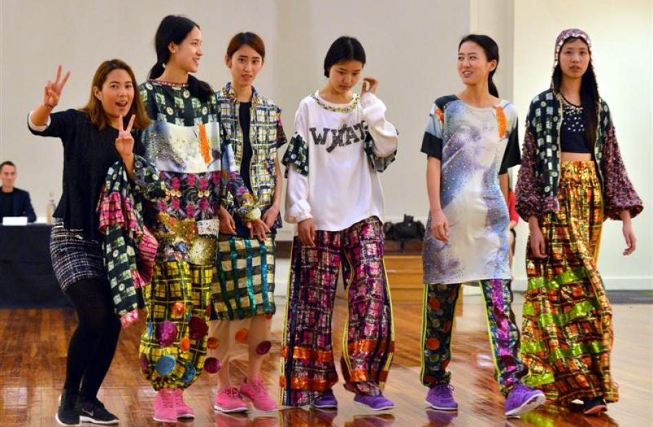 "Sydney designer Mook Attakanwong (22, left) finishes showing her collection ""Libertine"" to judges..."