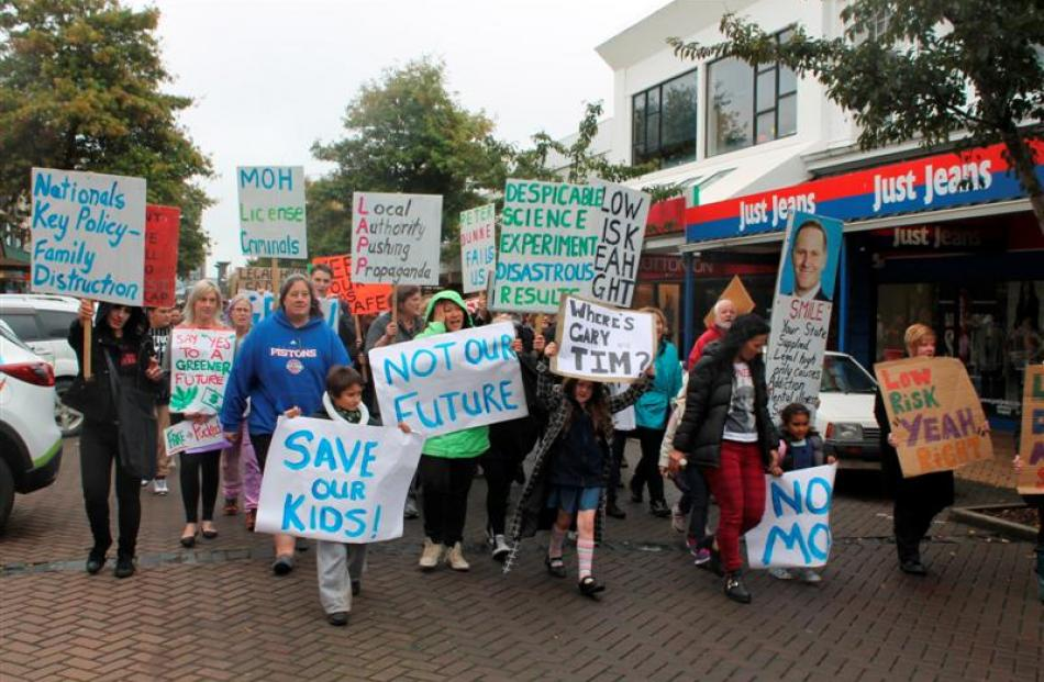 Protesters march along Esk St, central Invercargill, on Saturday,  during a  community protest...