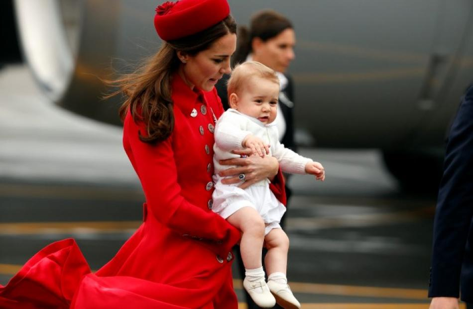 Catherine, the Duchess of Cambridge, holds her son Prince George after disembarking at Wellington...