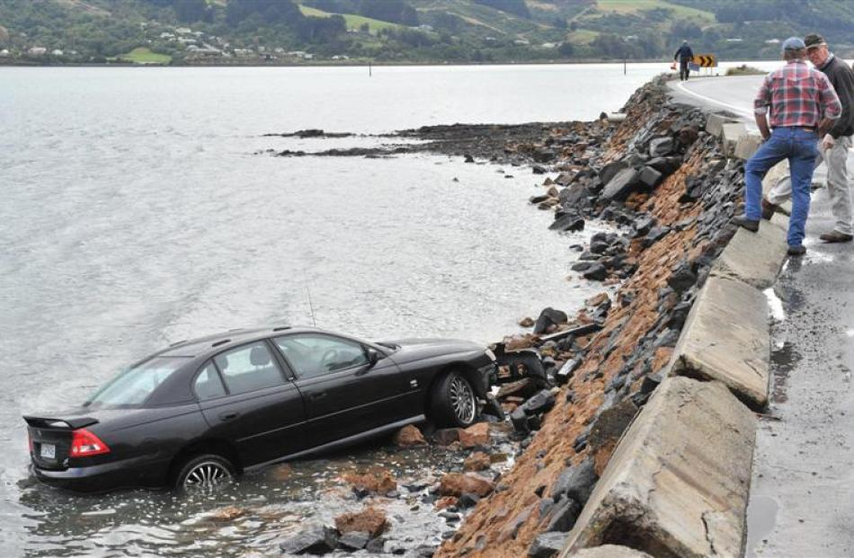 A Holden Commodore ended up in Otago Harbour at Company Bay, near Raynbird Rd, about 1pm on...