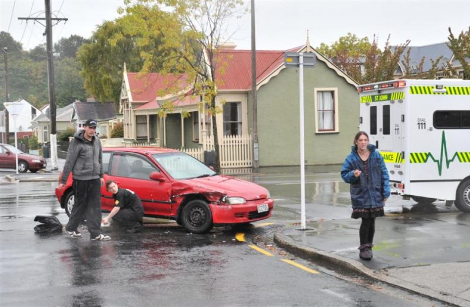 A Honda hatchback and a Holden Commodore crashed at the intersection of Cumberland St north and...