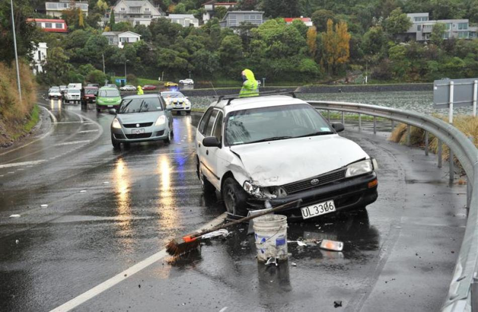 A Toyota Corolla station wagon and Nissan Bluebird crashed in Portobello Rd, near Doon St, about...