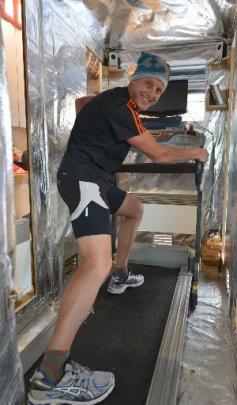 Glenn Sutton on his treadmill inside his heat box in his Dunedin home.