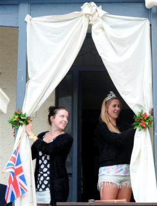 Hyde St flatmates Hannah Flett (20, left) and Shanyn Ruthe (20) prepare their 'Your Royal...