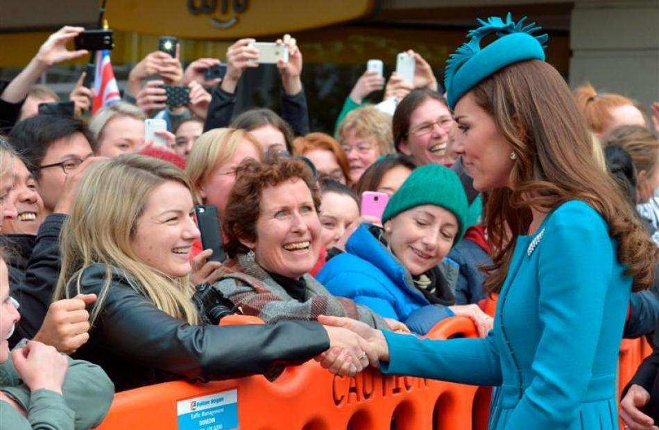 The Duchess of Cambridge greets some of the crowd in the Octagon, Dunedin, after attending a Palm...